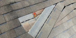 Picture of a damaged roof that needs repair to fix the lead. Taken in Honolulu, HI.